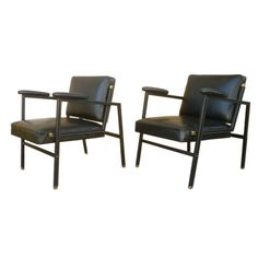 Jacques Adnet Chic Pair of Black Hand-Stitched Lounge Chairs | From a unique collection of antique and modern lounge chairs at https://www.1stdibs.com/furniture/seating/lounge-chairs/