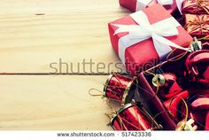 christmas concept. red gift on wooden background. over light and vintage color tone