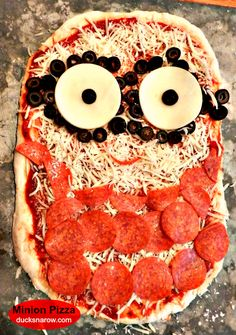 Make a minion pizza - a fun dish to serve at a family movie night featuring the minions!  #MinionMovieNight #ad