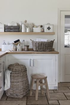 Country style laundry room - wicker, wood, natural bristle brushes, cream enamelware, jugs and tins.