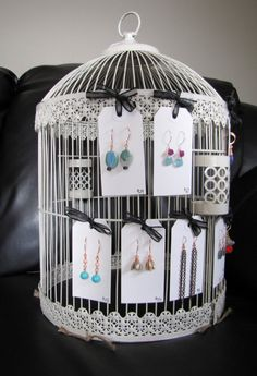 display idea from BailyBelleCreations.  She tied her earring cards to a vintage birdcage. - From The Factory: Craft Show Displays: Making the Most Out of Vintage