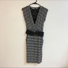 Maurices dress with belt Beautiful Grey, black and white dress comes with belt. (Tank top is just for show.) Soft and stretchy material. Falls below the knee. Only worn a couple of times. Great dress to wear to work or out to dinner!  #workattire #dress #Maurices Maurices Dresses Midi