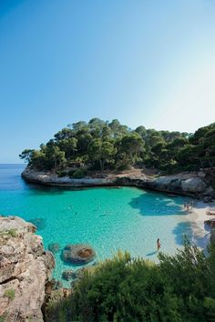 Because Cala Mitjana the main beach gets busy swim around a headland to Mitjaneta painted in a palette of dark green pines pale white limestone silver sand and teal water. There's only room for 20 or so sunbathers. Dream Vacations, Vacation Spots, Island Pictures, Balearic Islands, Beautiful Places To Travel, Travel Aesthetic, Spain Travel, Travel Photography, Night Photography