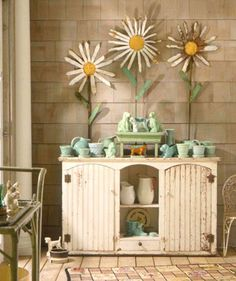 McCoy flowerpots, all in soft shades of blue and green.,,,,must make some of those huge daisies!!!