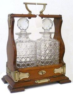 Oak tantalus decanter with two cut glass spirit bottles, with key, 33cm high