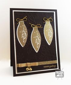 """Season's Greetings card made with:  - """"Deck the Halls"""" stamp set by Bethann Erin Silaika for Gina K Designs. - Gina K Designs Pure Luxury Dark Chocolate and 80 lb Layering Weight Ivory card stock.  - Gina K Designs Fine Detail Gold Embossing Powder. - Gina K Designs Gold Cording. - Gold ribbon and jingle bells from the Winter Cheer StampTV kit.  Check out Beth's """"Deck the Halls"""" stamp set in the Gina K Online Store at: http://www.shop.ginakdesigns.com/product.sc?productId=1570&categoryId..."""