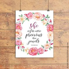 Bible verse printable, Proverbs 31:10 She is far more precious than jewels. Beautifully painted watercolor style wall art that is soft and feminine, with inspirational words for the Christian woman. Lovely as a birthday gift for that special friend, Mother's Day or just to decorate the home.