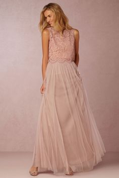 We love this bridesmaid separates pairing from designer Jenny Yoo. The cropped shell, which features delicate floral lace, is the perfect compliment to the tulle skirt. A striking combination of elegance, romance, and texture, try mixing and matching for a look that's completely yours. | Cleo Top and Louise Skirt in pink from BHLDN