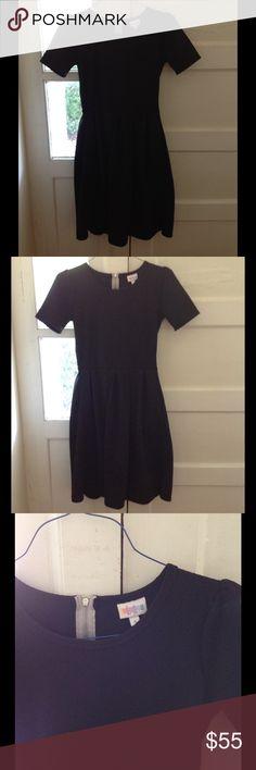 Black Amelia LulaRoe Dress Sz S NEW One size S Black Amelia dress. Light grey zipper up the back. Pockets. Nice heavy, stretchy material! Great quality. So so cute!!! Never worn. Never washed. Brand new without tag! LuLaRoe Dresses Midi