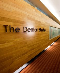 Our Doctors | Dental Studio Use of logo/name - maybe on curved wall with textured surface.