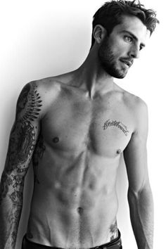 This is the guy everyone thinks is Adam Levine naked on a motorcycle. It's not. It this guy. Sexy and nameless for now
