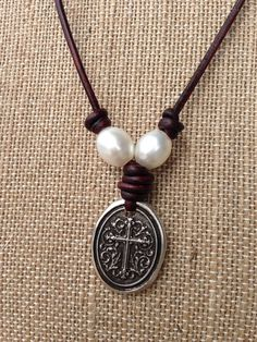 What a great and modern way to wear your faith around your neck! To creamy white freshwater pearls set on each side of a 1 inch oval pewter
