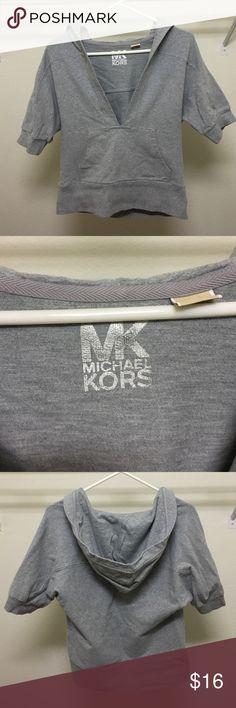 Michael Kors gray short sleeve hoodie. size M Michael Kors v-neck short sleeve gray hoodie. Front pockets. Gently worn. Very good condition. 95% cotton 5% spandex MICHAEL Michael Kors Tops Sweatshirts & Hoodies