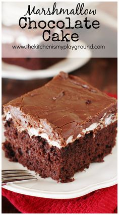 Marshmallow Chocolate Cake ~ Tender & tasty chocolate cake topped with a layer of gooey, melty marshmallow and rich chocolaty-fudgy icing. It's pure chocolate deliciousness! www.thekitchenism...