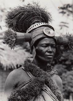 Africa | Dancer from the Ekona people. Isangi, Bikoro, Belgian Congo (today, the Democratic Republic of Congo) | Scanned postcard image, Photographer C. Lamote. ca. 1957