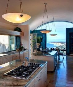 Look at that view!  Look at that kitchen!  Could I come and visit for a week, please?!