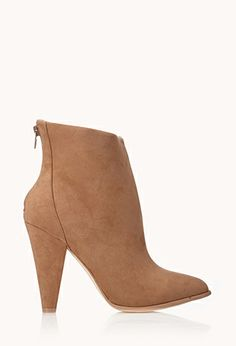 $32.00 I like the tapered look of this bootie in the heel even down to the point in the toe. It all looks so cohesive and feminine.