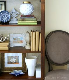 Bookcase makeover: Line the back with paper, genius!