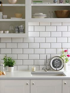 white tile backsplash with grey grout -- okay, so I actually don't like subway tile; do larger, smaller, square, squares as diamonds, other shapes, etc