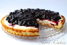 Blueberry Lemon cream cheese tart with a pecan short bread crust. Made with organic blueberries and cream cheese.