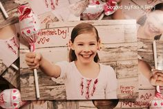 Photo card of kid holding lollipop