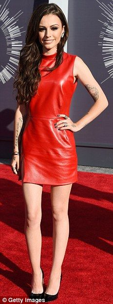Cher Lloyd heated up the carpet in a red leather mini at the 2014 VMAs http://dailym.ai/1oluLIj