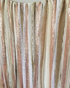 Rose Gold sparkle sequin mixed with burlap, various whites and ivory fabrics and lace. Torn and rag tied - edges are meant to fray. Perfect for accenting cake smash photo prop, cake table, nursery, doorways, ceremony stage, drape between trees or use as your photo booth background. Other garland uses: Special Events - bridal shower, baby shower, birthday parties, graduations, retirement parties, engagement photos. CUSTOMIZE!!!!! - Can be made any color blend, width or length - convo for…