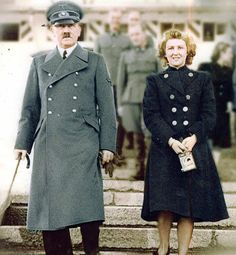 Adolf and Eva in colour.... Notice he's walking with a cane. The bastard needed drugs to cope with his megalomania. And how could she be with a nut like him? She was the same I suppose.