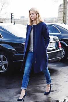 Shop this look on Lookastic:  http://lookastic.com/women/looks/grey-crew-neck-sweater-navy-coat-blue-skinny-jeans-navy-pumps/5964  — Grey Crew-neck Sweater  — Navy Coat  — Blue Skinny Jeans  — Navy Suede Pumps