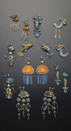 China   Seven pairs of gilt metal and Kingfisher feather earrings; variously formed as fish, dragons, foliate arrangements and insects, decorated with pearls, coral, jadeite and other stones, one pair mounted with amber butterfly plaques, together with a single model of a grasshopper perched on a jardinière of flowers, 9 cm max.   Qing Dynasty   2'600£ ~ sold (May '15)