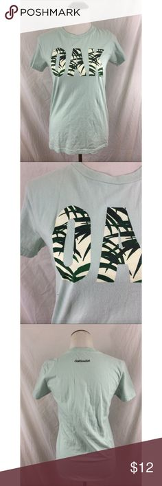 """OAKLANDISH """"OAK"""" tropical tee shirt Brand : Oaklandish  / Size : L  / Condition : perfect condition  / Measurements :  Length : 26in  / Bust : 16in  • OAK in tropical block letters • light green Oaklandish Tops Tees - Short Sleeve"""