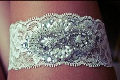 Use a piece of lace from your mom's wedding gown for a keepsake garter | Photo: All The Good Girls Go To Heaven