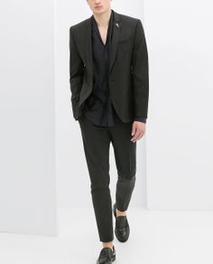 """A well fitting basic black suit. It's every dude's equivalent to the """"Little Black Dress""""."""