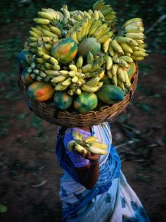 I used to walk around with a basket on my head, trying to be as amazingly strong as the women I used to see doing this!