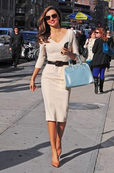 love! -- melissa  Miranda put a modern spin on classic style — looking glamorous as ever — in a cream-colored Victoria Beckham dress accessorized with a light-blue Prada tote, Lanvin heels, and Miu Miu sunglasses.
