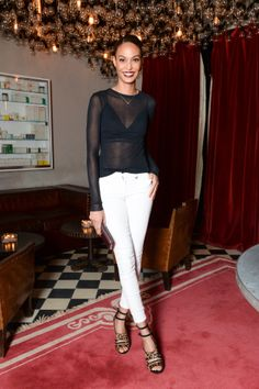 Joan Smalls plays up a simple black and white outfit with leopard-print shoes: