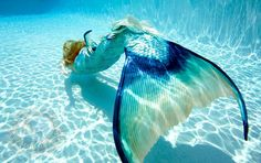 Beautiful underwater shot of a silicone mermaid tail, as the mermaid swims away into the distance.