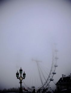 love how the ferris wheel disappears into the mist...