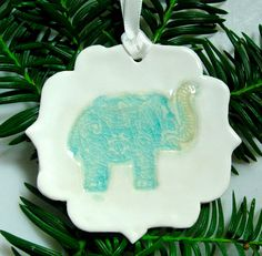 This beautiful handmade ceramic Christmas tree ornament, featuring a lucky elephant, will become instant heirloom in your family. I made this pretty