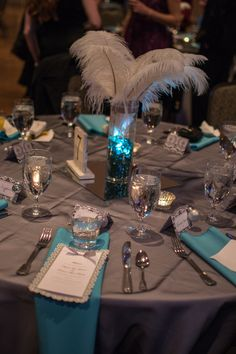 Our black, white, and teal wedding Escort cards with ornaments