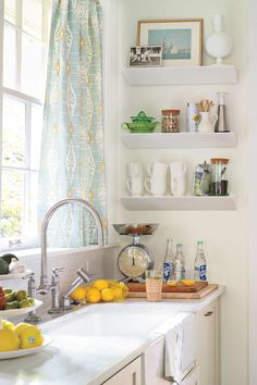 """Details Make a Difference - Hardworking Small Kitchen Redo - Southernliving. Narrow, 6-inch deep shelves turn an empty wall next to the sink into a coffee niche.    Jessica also found an InSinkErator disposal controlled with a countertop button while searching for kitchen gadgets online. """"It's my ultimate must-have,"""" she says.  Wall shelves: Wedge Wall Shelf in White from CB2"""