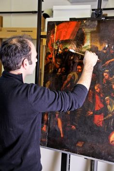 Radovan cleans a 300 year old painting