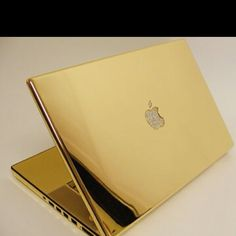 The gold MacBook Pro, with diamond studded Apple logo Most expensive laptop all gold 1 million Bling Bling, Mac Book, Roller Disco, Apple Logo, Gold Party, Macbook Pro Cover, Gold Everything, Or Noir, Apple Laptop