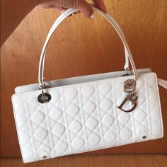 🎉 2X HP🎉 Authentic Dior Lady Dior Bag Gorgeous! Only carried twice. Has 3 tiny stains and tiny hole as shown. Otherwise excellent condition. Cute Dior bag charms attached. White leather. Quilted. 14x6x7 inches. Comes with dustbag. Purchased from the Dior boutique in Beverly Hills.  No trades. Dior Bags