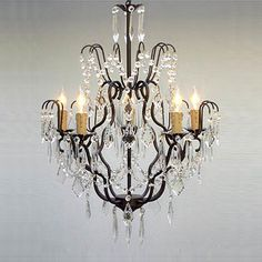 This beautiful chandelier from Regent features five lights and is decorated and draped with 100-percent crystal accents. The iron finish adds elegance and freshness to this chandelier.