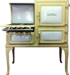 Glenwood Insulated Retro Gas Antique Cook Stove in yellow & white. Sales price without tax: $5,850.00