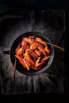 Herb-Roasted Carrots | A simple side of perfectly roasted carrots is the breather a crowded Thanksgiving table needs—a bit of palate relief (and ease for the cook) that still looks elegant. Sweet, slightly firm, and tossed with fresh parsley and cilantro, these carrots would fit here and all season long. Use any remaining cilantro in leftover turkey tacos or chili. For an extra-pretty presentation, cut the carrot pieces at a 45° angle before roasting.