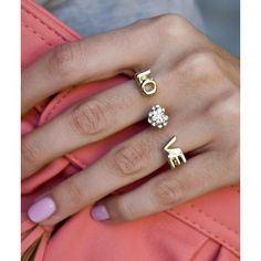 """Multiple finger ring in gold, featuring pave' diamonds.  This ring will take up space across your entire hand.  First, featuring a capitalized, """"L"""" & """"O"""" in gold & second, a gold-set pave' diamond heart, finally third, features a gold capitalized, """"V"""" & """"E"""".  Across your hand is spelled, """"LOVE"""", with a pave' heart in the middle."""