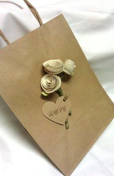 Wedding favor bags. wedding gift bags. gift bags. Paper rose wedding favor. Ivory roses. Wedding favors make for bridesmaid favours