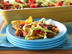 Easy Nacho Bake - Wait to add lettuce, tomato and sour cream at the table and you can reheat leftovers.